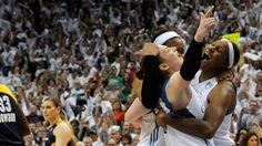 (L-R) Lindsay Whalen, Maya Moore and Sylvia Fowles of the Minnesota Lynx celebrate a win in Game Five of the 2015 WNBA Finals against the Indiana Fever on October 14, 2015 in Minneapolis, Minnesota