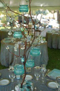 Turquoise treetop table centerpiece.