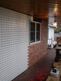 Thin Brick Veneer Installed Over Concrete Foundation By