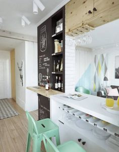 Compact flat 45m2, white, wooden, pastel chairs, chalkboard wall, pastels, deer