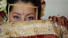 http://maharaniweddings.com/2013-01-03/2575-seaside-indian-wedding-mehndi-haldi-and-ceremony-by-robles-video-productions-huntington-beach-california Seaside Indian Wedding Mehndi, Haldi & Ceremony by Robles Video Productions, Huntington Beach, California. A three-day Indian wedding unfolds at Huntington Beach, California. The South Indian bride wears a red wedding sari with jasmine flowers in her bridal hair