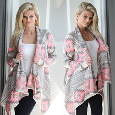 YOU NEED THIS! This Neon Pink Aztec Cardigan has made us fall in LOVE! The fit and print are perfect for any occasion! We love this comfy piece and the beautiful BRIGHT neon pink is just to die for! The asymmetrical hem give this cardigan and one of a kind feel! Check out other cute cardigans at our online boutique!
