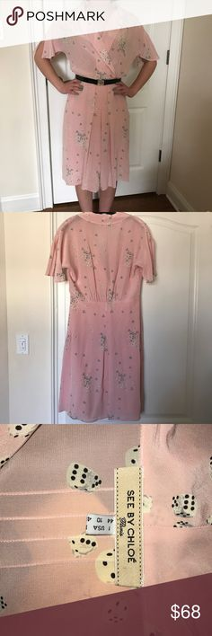 See by Chloe silk dress See by Chloe pale pink silk dress. New without tags, never worn. Scattered black and white dice print. Fully lined skirt. V-neck style neckline. Italian size 10, fits small, more like 6-8. Shown on size 4 model. Belt not included. See by Chloe Dresses Midi