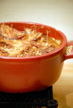 "Onion Soup Lyonnaise-Style. ""From the Lyon region of France, this onion soup is much thicker than the usual kind. It's often served as a late-night dish. When I was a young man, I often made it with my friends at two or three A.M. after returning home from a night of dancing."" Jacques Pépin"