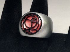Replica of the rose seal ring (バラの刻印) from Revolutionary Girl Utena. Plastic rings are durable, lightweight, affordable, and perfect for cosplay!  Available in TV Anime, Movie, and Black Rose styles and 8 sizes (US 5-12). All rings come in Rose Pink by default; custom colors are available upon request.
