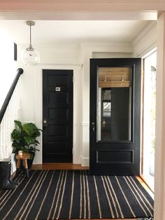 Is your entryway ready for spring living spaces entryway dec Painted Interior Doors, Black Interior Doors, Door Design Interior, Interior Paint, Paint Doors Black, Black Front Doors, Decoration Bedroom, Entryway Decor, Door Entryway