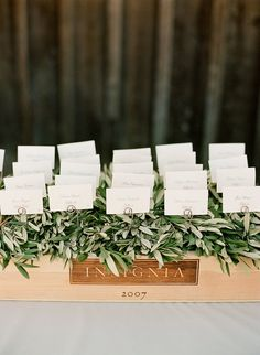 olive leaf escort card display by dream a little dream events