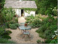 love the vines & gravel pathway leading to the shed