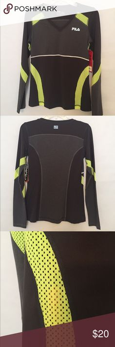 🆕 Fila Sport dark gray/neon lemon pullover Fila pullover in two shades of dark gray with neon yellow mesh insets on sides, sleeves, shoulders and underarms. Insets are reflective for safety. V-neck, moisture wicking fabric 85% nylon/15% spandex. Fila Tops Tees - Long Sleeve