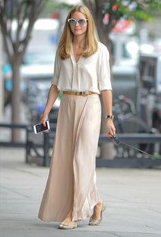 Olivia Palermo casually strolling around NYC in white blouse and pale pink skirt. Check out YouQueen.com for her style secrets revealed.