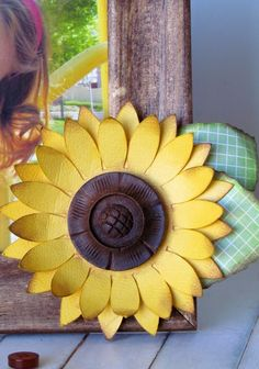 DIY Summer Sunflower Frame made from a dollar store frame, a wood button and @silhouettepins