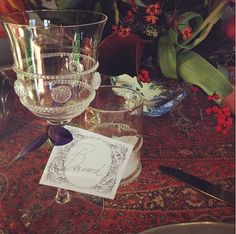 Little place cards are tied to the wine goblets so people know where to sit and which glass is theirs as we migrate through the house during the afternoon. Wine Goblets, Holiday Traditions, Tablescapes, Wine Glass, Whimsical, Alcoholic Drinks, This Is Us, Place Cards, Table Settings