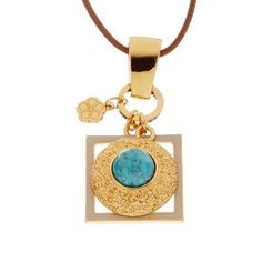 "Trina Turk ""Charm"" Resin/Enamel Necklace Lovely necklace on par with all of Trina Turk's creations. Gold tone base metal with brown rope (Apprx 24"" long) and tie clasp. Pendant is round bezel shaped turquoise resin with white enamel. Pendant apprx 1.22"" wide, 2.36"" long. Brand new, unwrapped just for photos. Trina Turk Jewelry Necklaces"