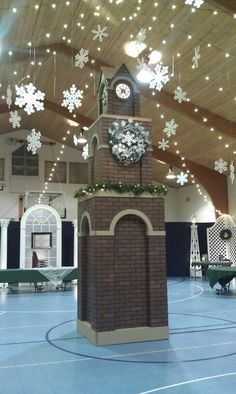 Optrics clock tower and winter decor for a December wedding reception. Tower is 16' tall.