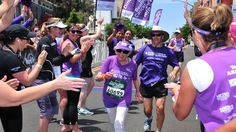 After a tough run, Harriette Thompson, 91, still has a smile on her face as she finishes the 2014 Suja Rock 'n' Roll San Diego Marathon. Her son, Brenny, 55, is running behind her.