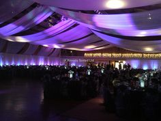 Wedding reception draped and lit in lilac... could we do this in the Grand Hall?