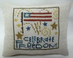 This 6 1/4  x 4 3/4  mini pillow would be great for July 4 or any time you want a patriotic touch for your home. It is stitched on sand Carolina linen , backed with cotton fabric, and stuffed with polyfil. It has two blue star buttons as an added touch. Some overdyed floss is used for subtle color variations. Design by Bent Creek.