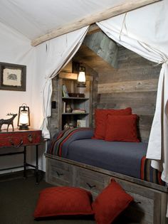 Pioneer camp themed loft bedroom. Would also make a classic African safari camp idea too. Reclaimed Corral Board Paneling on the wall and bed. White Jute Burlap Curtain drapes. Vintage case nightstand. Pendleton Yakima camp blanket.