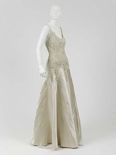 """Dress, Evening  House of Chanel (French, founded 1913)  Designer: Gabrielle """"Coco"""" Chanel (French, Saumur 1883–1971 Paris) Date: 1938 Culture: French Medium: silk Dimensions: [no dimensions available] Credit Line: Gift of Mrs. Harrison Williams, Lady Mendl, and Mrs. Ector Munn, 1946"""