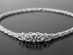 """GRADUATED BYZANTINE NECKLACE MATERIALS: 20AWG, 18AWG, 16AWG AND 14AWG STERLING SILVER & CRAB CLAW CLASP PATTERN: BYZANTINE NUMBER OF RINGS: 250 DIMENSIONS: 3/16 - 1/2"""" WIDE"""