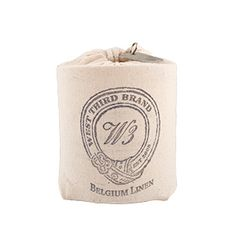 West Third Brand Belgium Linen Candle - Packaged in a hand stamped cotton sack adorned with an ages West Third metal tag. All cotton wick.
