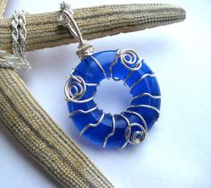 Eco Friendly Wine Bottle Cobalt Blue Glass Pendant  Repurposed Recycled Upcycled  215201302. $23.79, via Etsy.