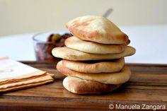 Cabbuci - Italian Pita Bread | 450 g durum wheat flour, 3 tbsp of extra virgin olive oil, 1 tsp of salt, 250 ml lukewarm water, 1 sachet of dry yeast (7 g), 1 tbsp of sugar