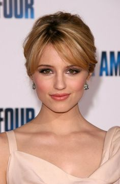 Dianna Agron loose bun hairstyle from the front. Pretty bangs and soft gentle updo.