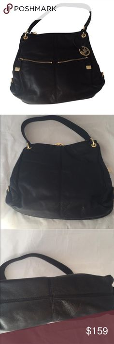Michael kors hobo Gorgeous black soft leather michael kors hobo bag with front gold zipper pockets, and side buckle details. Inside has 3 different compartments. Very good condition. Just minor wear on corners shown in photos, and small mark on bottom of bag also shown in photo. No PayPal or trades reasonable offers via offer option only. Michael Kors Bags
