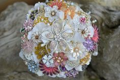 Turn your precious pieces of jewelry into an heirloom brooch bouquet. Contact www.etsy.com/shop/Noaki