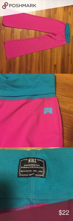💗💕Nike hot pink yoga pants Hot pink Nike Yoga pants with blue trim. Super comfy and colorful. Fits women size S or XS. Check pic for measurements. Worn once and very gently used. Practically new. Nike Pants Track Pants & Joggers