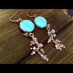 Earrings Gold tone fishhook earrings featuring a round turquoise stone with a dangling cluster of topaz beads.  Approximately 2 inches in length. Jewelry Earrings