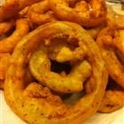 Beer Battered Onion Rings      2 cups all-purpose flour, 1 egg, beaten, 2 t dried parsley, 2 t garlic powder, 2 t dried oregano, salt&pepper to taste, 1 cup beer,  3 lg onions, sliced into rings.  Combine flour, parsley, garlic powder, oregano, salt,pepper & egg. Gradually add beer, stirring forming thick batter. Add more or less beer for consistency.  Fry.  Drain on paper towels.