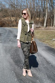 Pastel Camo: blush blouse, coral/mint statement necklace, olive utility vest, camo pants, nude d'Orsay pumps, Louis Vuitton MM tote