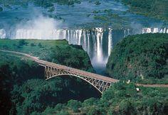 "Victoria Falls ~ Mosi-oa-Tunya  - the ""Smoke that Thunders"" (between Zambia and Zimbabwe) - 1 mile wide and 360 feet high."