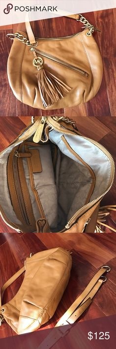 Michael Kors Sz M hobo style caramel leather bag Nothing other than fabulous describes this best.  New - carried twice. It's super cute but too small for me (I carry the lg and xl bags - can't break old habits😊). This has goldtone hardware with the fringe tassel MK medallion as a zipper pull. Comes with the shoulder strap MICHAEL Michael Kors Bags