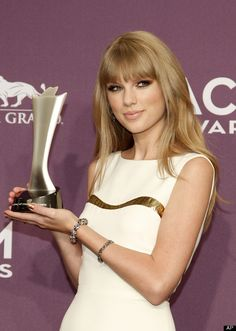 Taylor Swift poses backstage with the award for entertainer of the year at the 47th Annual Academy of Country Music Awards on Sunday, April 1, 2012 in Las Vegas.