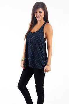 """Ruffle Back Tank, Navy        $39.00   Our best selling tank is back but this time, with polka dots!!! This one is doubled layered and great for pairing underneath cardigans or a blazer!   Fits true to size. Miranda is wearing the small.    From the shoulder to the hem:  S-24""""  M-25""""  L-26"""""""