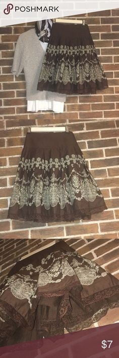 Brown & Cream skirt w/lace Brown skirt with beautiful cream design. It is fun and bells out with beautiful brown lace at the trim. It is lined and it is an apt 9 size 8P. Apt. 9 Skirts