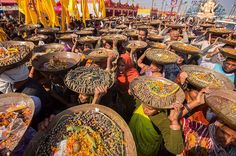 Hindu offering ceremony at Kumbh Mela 2013 festival in India (the largest gathering on Earth with 50+ million people!). More photos: http://www.loupiote.com/sets/72157635123476692.shtml
