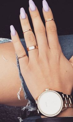 A sweet, flattering shade of pale purple looks beautiful with this long, feminine coffin nails.
