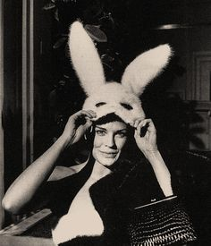 Candice Bergen lifting her Halston designed mask at Truman Capote's Black & White Ball.
