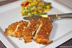 Our Baked Parmesan Chicken is great as a main dish or on salad!
