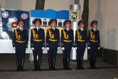 Honor guardsmen of the Internal Troops of Ukraine in their parade dress uniforms honor the deceased policemen at Kharkiv.