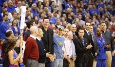 Former Kansas center Eric Chenowith smiles with other members representing the Roy Williams era during ~ 2.23.13