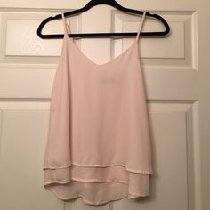 Light pink/ rose sleeveless blouse Perfect with a blazer for work or with shorts for a more casual look. Worn twice- no damage or signs of wear. 100% polyester. 2 thin layers so it is not sheer. Fits size XS. Shinestar Tops Blouses