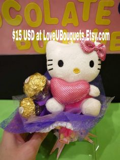 1 kitty doll in a mini flower bouquet with 3 Ferrero Rocher chocolates