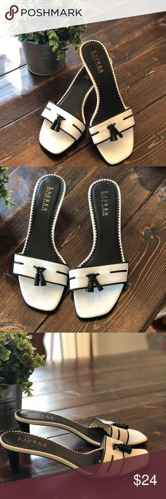 """Lauren Ralph Lauren Cora Sandals, Sz 8.5 Ralph Lauren Cora Sandals in navy and white. Adorable sandals for the warmer months ahead! Fun tassel detail and 2"""" heels will make these your go-to sandals!  Shoes are in great condition other than some signs of wear on the bottoms and a few spots where footbed has rubbed down. Please see pics! Lauren Ralph Lauren Shoes Sandals"""