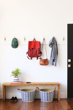 We installed this hook series in a cabin project last summer. It couldn't have been easier. Just a primed pine board from the hardware store and a series of these brass hooks! DONE! - Anthro streamline hook $16 (via Little Green Notebook)