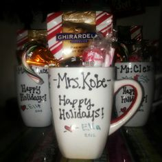 A Dollar Tree mug decorated with Sharpie markers (baked for 30mins @ 350 and allowed to cool completely) and filled with a pack of Ghirardelli Peppermint Hot Cocoa mix, thin mint patties, a Hershey's chocolate mint candy cane, a peppermint Tootsie Pop, and chocolate dipped peppermint sticks! About $1.75 a piece, great teacher gift ideas!